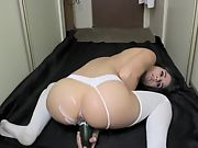 Lovely dark-haired camgirl drains in the corridor