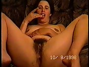 Holly spreads her legs and fingers hairy muff and tongues fingers
