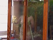 Cleaning the windows naked for the neighbours to see