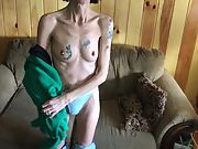 Skinny tattooed granny disrobing and showing her hairy pussy